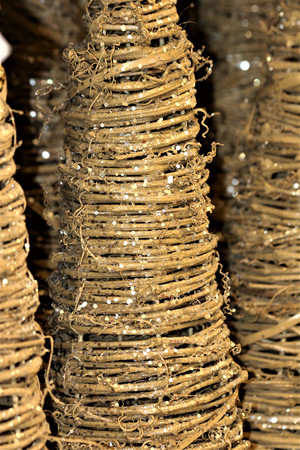 Golden sparkling grapevine Christmas trees close-up. Stock Photo