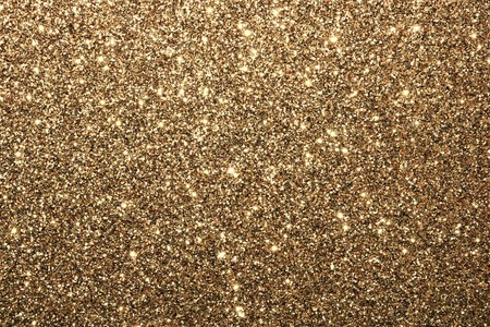 Sparkling gold glitter background with room for text.