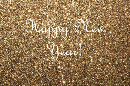 Happy New Year on gold glitter background.