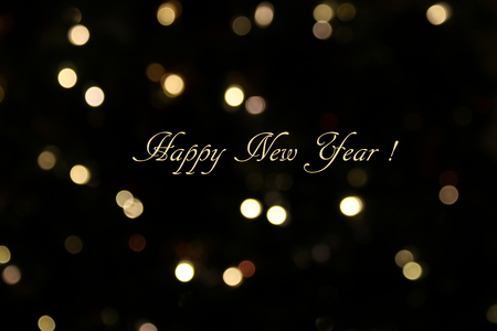 Happy New Year text on black and gold glitter background.