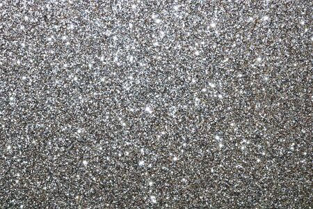Sparkling silver glitter, rough texture abstract, background with copy space.