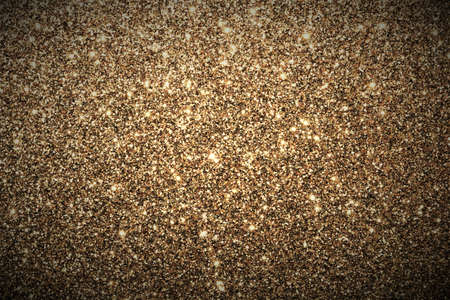 Sparkling gold glitter full frame abstract background. Stock Photo