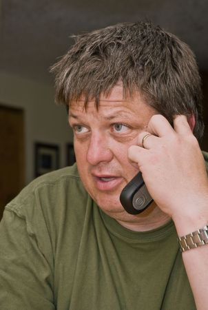 attentiveness: Concerned adult male talking on a cell phone