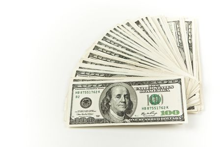 hundred dollar bills fanned out on white background