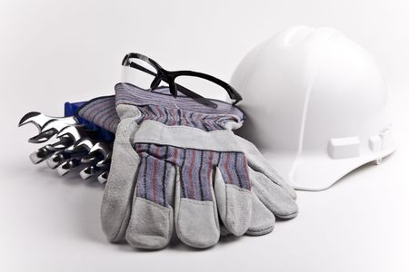 personal protective equipment: close up hard hat leather gloves safety glasses wrenches