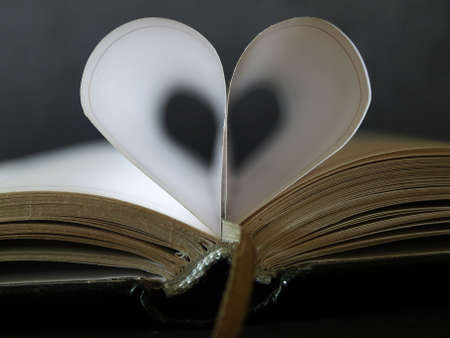 Book with heart in black background