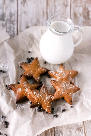Star shaped gingerbread. Cookies for Santa. Rustic style breakfast