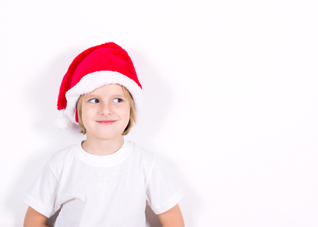 Happy boy in Santa red hat. Christmas concept.