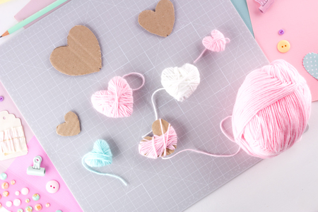 Making diy project. Knitting decoration. Craft tools and supplies. Season home valentines day decor 写真素材