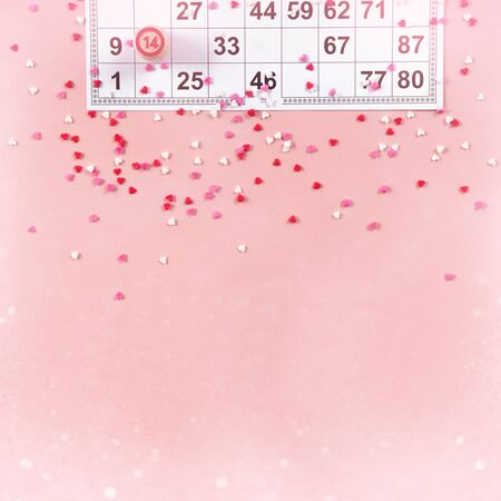 Lotto ticket with wood barrel 14 number on pink hearts background. Valentines day 14 february minimal concept. Square format. bokeh effect
