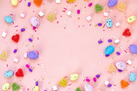 Top view shot of arrangement decoration Happy Easter holiday background concept. Flat lay colorful bunny eggs on beautiful pink desk. Copy space.