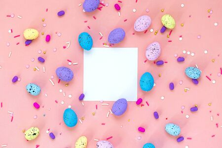 Top view shot of arrangement decoration Happy Easter holiday background concept. Flat lay colorful bunny eggs on beautiful pink desk. White notes. Copy space