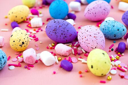 Decoration Happy Easter holiday background concept. Colorful bunny eggs on beautiful pink desk