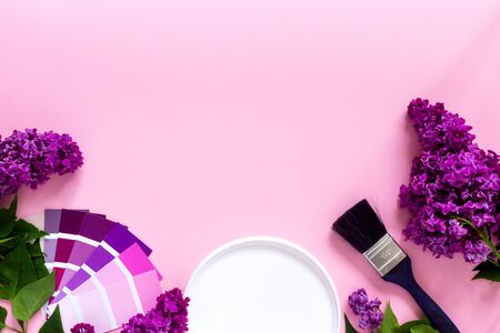 DIY minimalist design concept. Trendy color samples - pink, lilac, purple, magenta and paint brush on pink background. Repair, alteration, creative, art supplies.Top view. Banner. Copy space