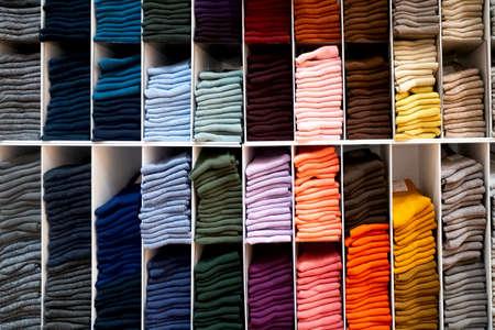 Multicolored bright socks on shelve in store 版權商用圖片