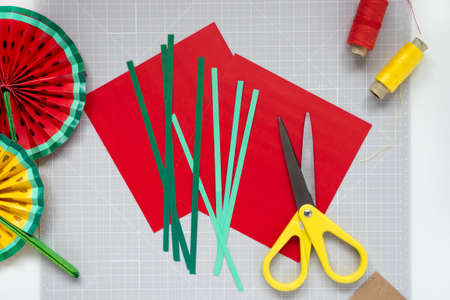 DIY instruction. Step by step tutorial. Making decor for summer birthday party - red and yellow watermelon fan. Craft tools and supplies. Step 2