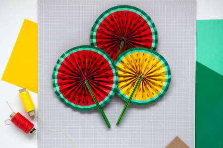 DIY instruction. Step by step tutorial. Making decor for summer birthday party - red and yellow watermelon fan. Craft tools and supplies. Step 8 - Final