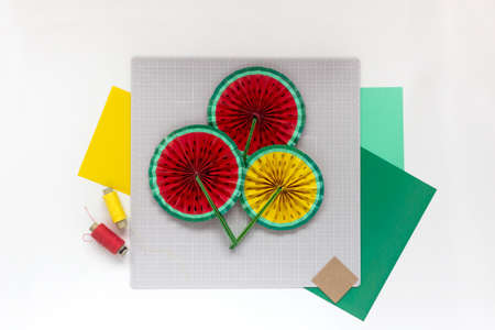 DIY instruction. Step by step tutorial. Making decor for summer birthday party - red and yellow watermelon fan. Craft tools and supplies. Step 8 -Final