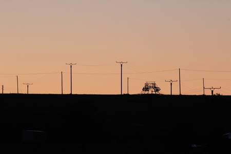 rwe: Electricity pylons in the countryside against the evening sky