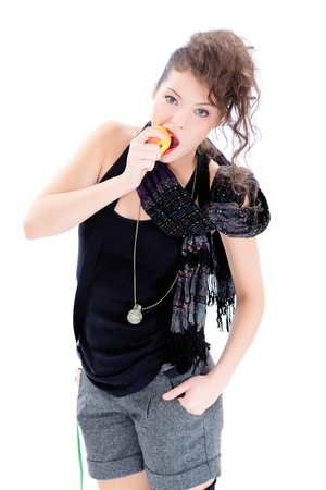spanned: Young woman eating an aplle isolated on white Stock Photo