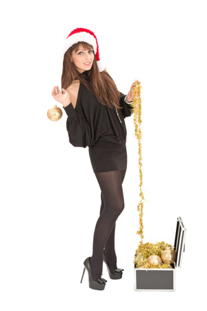 Beautiful smiling christmas santa woman with gold ball Stock Photo - 23376163
