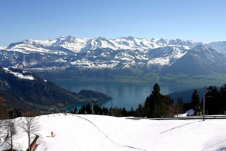 Snow, lake and mountains in Switzerland Stock Photo - 4303500