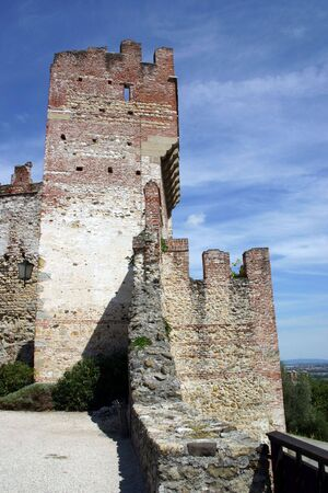 ramparts: Castle ramparts against a blue and white sky in Marostica, Italy