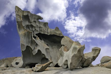 Natural sculpture against blue sky and clouds at the Remarkable Rocks outcrop in Flinders Chase National Park on Kangaroo Island, South Australia Stock Photo