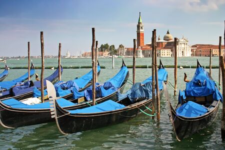 Gondolas moored by the Piazzetta di San Marco in Venice with the Isola di San Giorgio Maggiore across the canal in the background