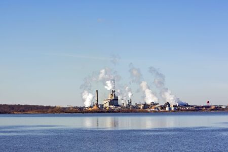 carbon pollution: Factory smokestacks on the James River near Hopewell, Virginia Stock Photo