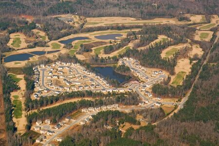 Aerial view of a golf course and housing development near Atlanta, Georgia in winter with trees photo