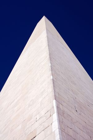Close-up view straight up the Washington Monument framed by dark blue sky photo