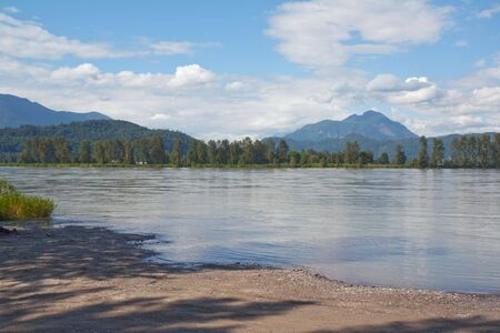 fraser river: View of the Fraser River in British Columbia, Canada, with blue sky and white clouds