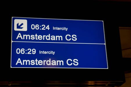 Sign for the train to Amsterdam, the Netherlands, from the platform at Schiphol Airport Stock Photo - 7658232