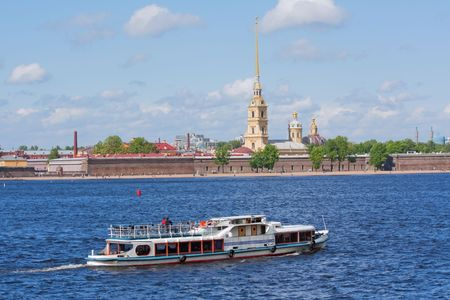 Water taxi motors by the Peter and Paul Fortress on the Neva River in Saint Petersburg, Russia photo