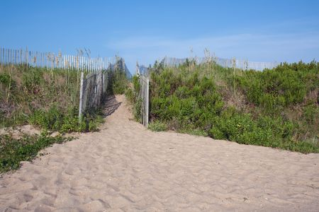 Walkway over sand dunes to a beach in Kitty Hawk, North Carolina, USA photo
