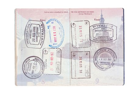 Stamps from Australia, Italy, the Netherlands and USA in a United States passport isolated on white