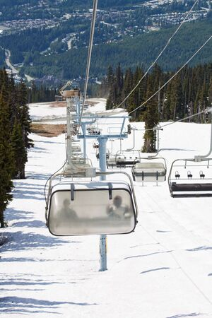 ski runs: Chair lifts for the ski runs at Whistler Peak in British Columbia, Canada vertical Stock Photo