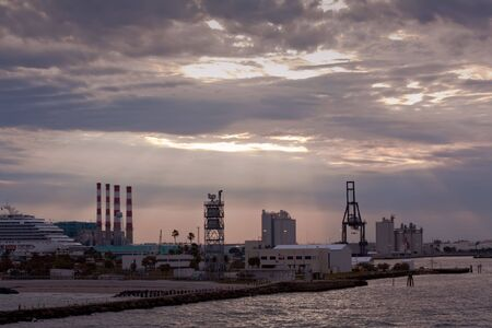 everglades: Silhouette view of the Port Everglades cruise ship and containerized cargo terminal in Fort Lauderdale, Florida, under a dramatic sky at sunset Stock Photo