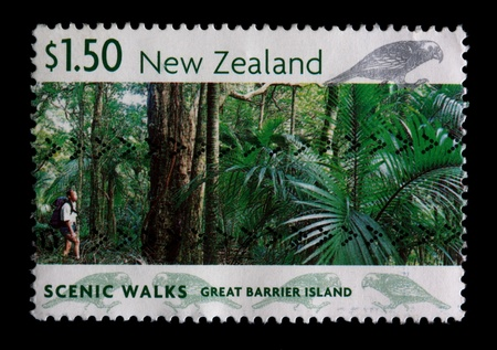 barrier island: A $1.50 stamp printed in New Zealand shows a hiker in a rainforest, Scenic Walks series, great barrier island, circa 1999