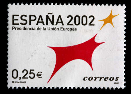presidency: A 0.25 euro stamp printed in Spain shows red and gold symbols celebrating the presidency of the European Union, circa 2002
