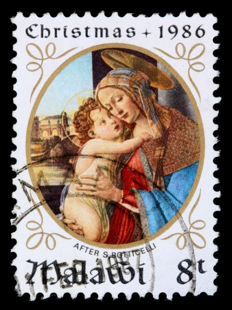 MALAWI -CIRCA 1986: An 8-tambala Christmas stamp printed in Malawi shows the Madonna and child after S Botticelli, circa 1986