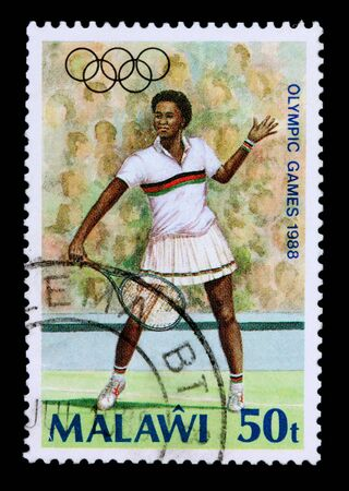 MALAWI - CIRCA 1988: A 50-tambala stamp printed in Malawi shows a tennis player to commemorate the olympic games, circa 1988 Stock Photo - 9511998