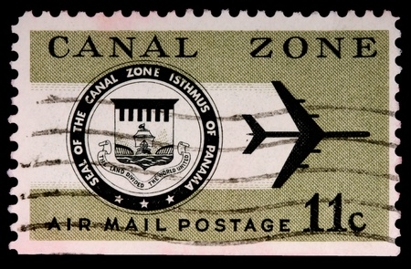 isthmus: CANAL ZONE, PANAMA - CIRCA 1973: An 11-cent air mail stamp printed in the Canal Zone, Isthmus of Panama, shows the Canal Zone seal and a jet, circa 1973