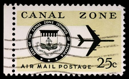 CANAL ZONE, PANAMA - CIRCA 1973: A 25-cent stamp printed in the Canal Zone, Isthmus of Panama, shows the Canal Zone seal and a jet, circa 1973 Editorial