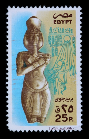 postmark: EGYPT - CIRCA 1980: A 25-piastre stamp printed in Egypt shows a statue of a pharaoh and hieroglyphics, circa 1980