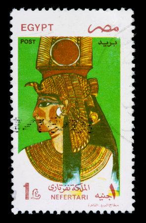 postmark: EGYPT - CIRCA 2000: A 1-pound stamp printed in Egypt shows Queen Nefertari wearing a royal headdress, circa 2000 Editorial