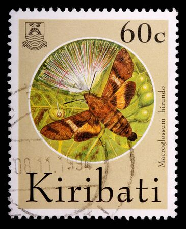 KIRIBATI - CIRCA 1994: A 35-cent stamp printed in the Republic of Kiribati shows the sphinx moth, Macroglossum hirundo, and a flower, circa 1994