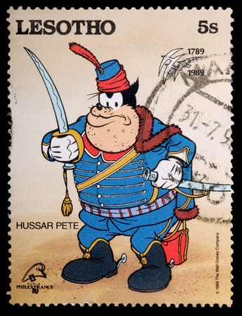 LESOTHO - CIRCA 1989: A 5-sente stamp printed in the Kingdom of Lesotho shows the Disney character Hussar Pete, circa 1989