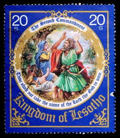 commandment: LESOTHO - CIRCA 1988: A 20-sente stamp printed in the Kingdom of Lesotho shows the second commandment, circa 1988 Editorial